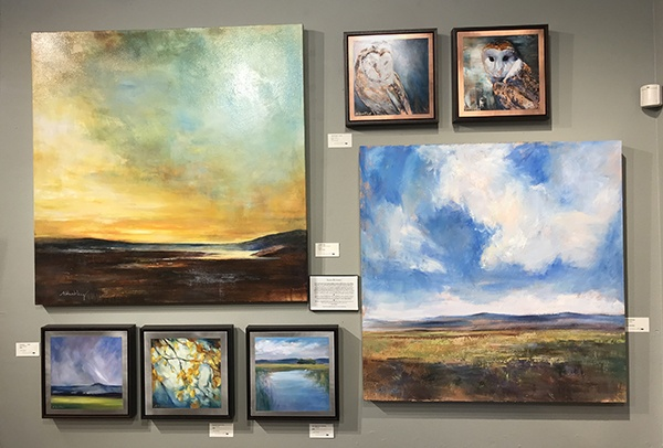 Alisa Huntley's wall of fine art at Tumalo Art Co.