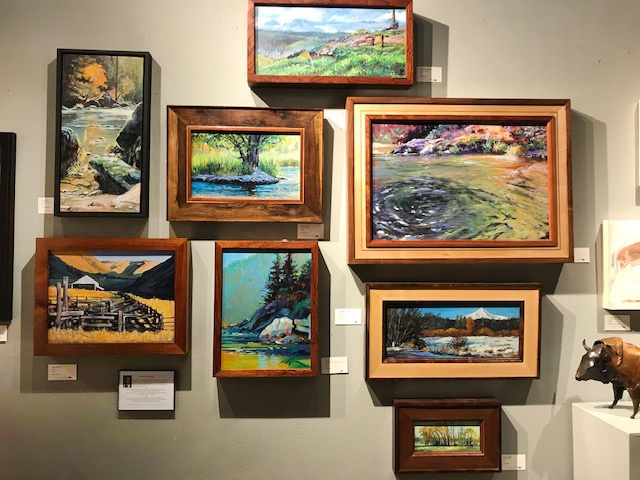 David Kinker's wall of paintings and his hand-made custom frames